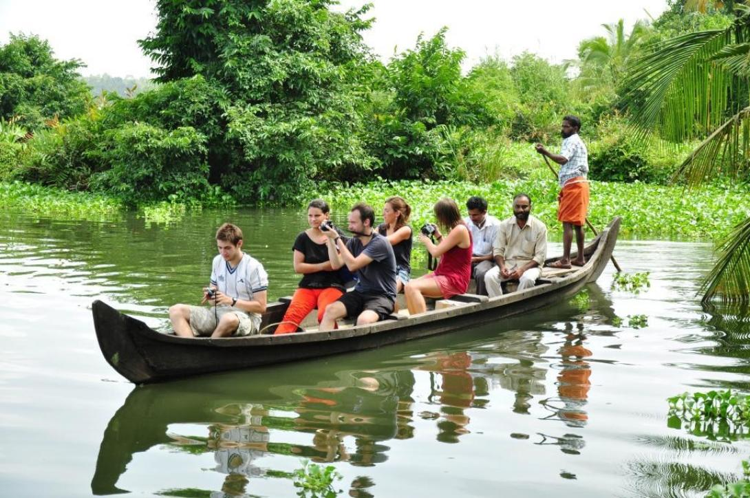 Projects Abroad volunteers floating through the Kerala Backwaters by boat in India.
